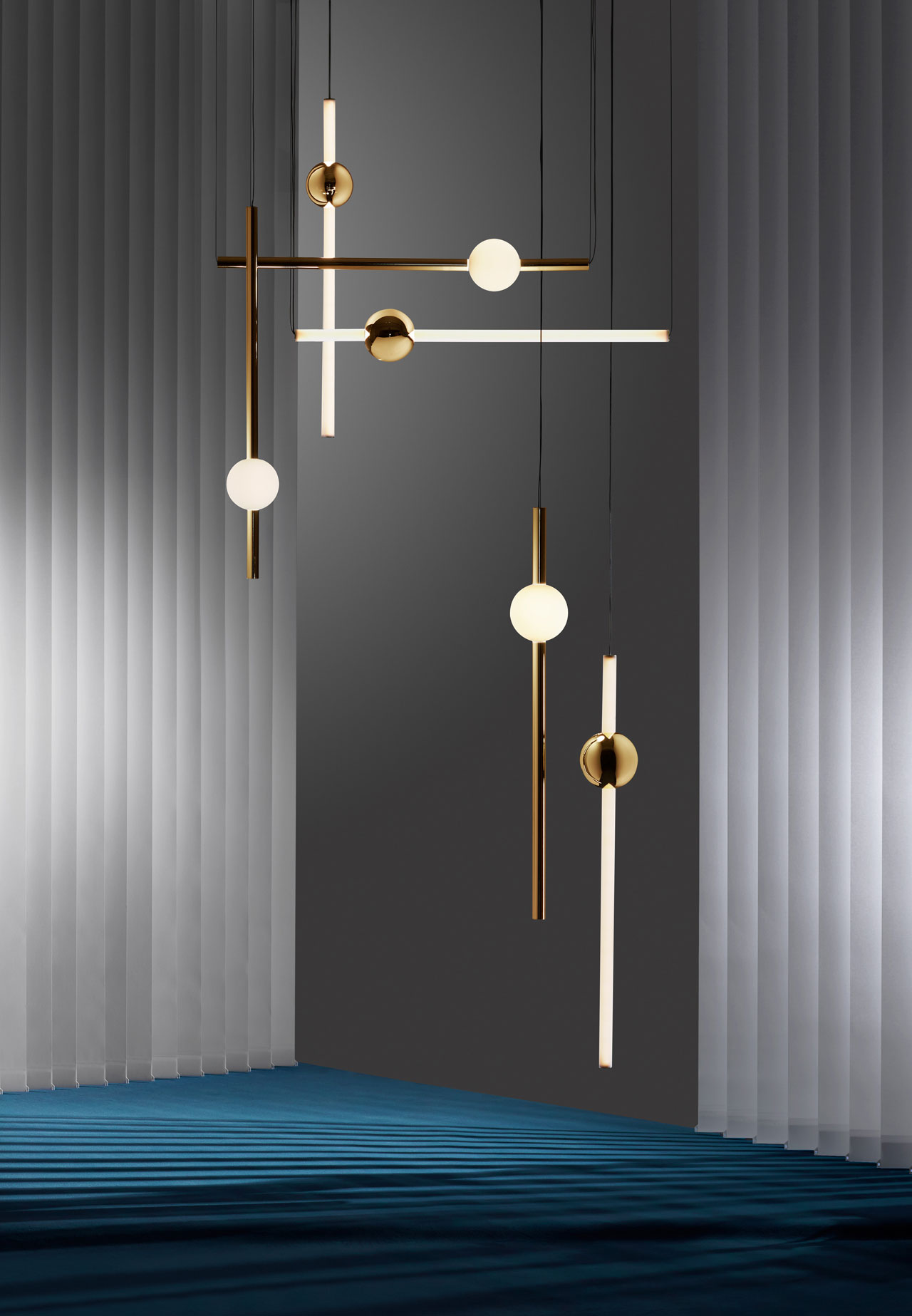 Orion by LEE BROOM comprises simple modular tube lights with opposing opaque and solid polished gold spheres which connect and expand horizontally and vertically to create bespoke constellations of light.