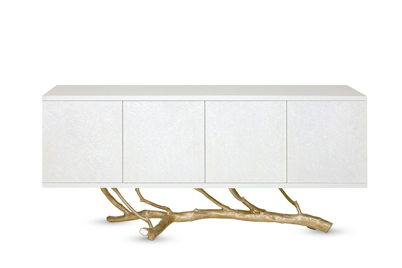 Standing on top of a magnolia tree branch molded in brass casting, the Magnolia Sideboard symbolizes Nature's foundational role in all creation. The sideboard has four compartments, one with four sliding drawers. Photo© Ginger & Jagger.