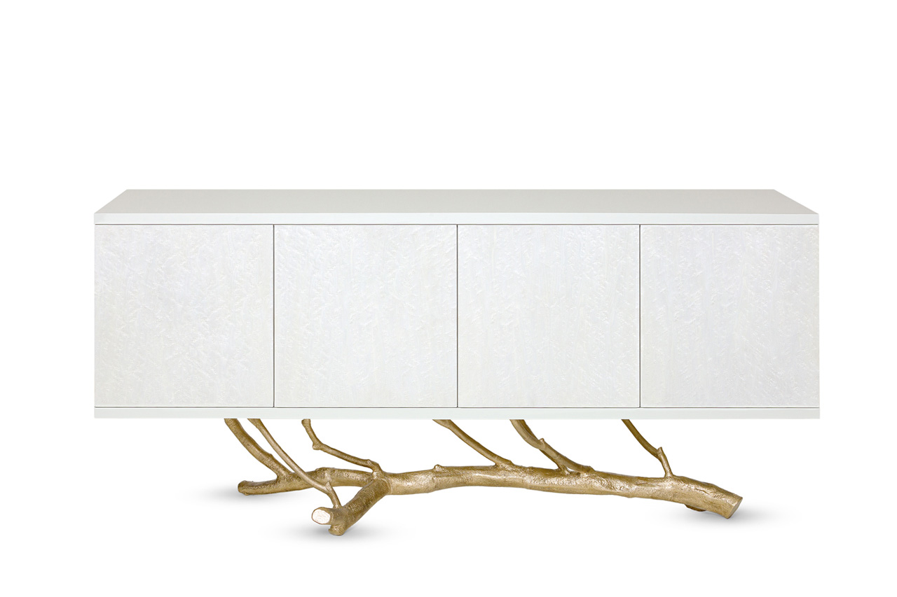 Standing on top of a magnolia tree branch molded in brass casting, the Magnolia Sideboard symbolizes Nature's foundational role in all creation. The sideboard has four compartments, one with four sliding drawers. Photo © Ginger & Jagger.