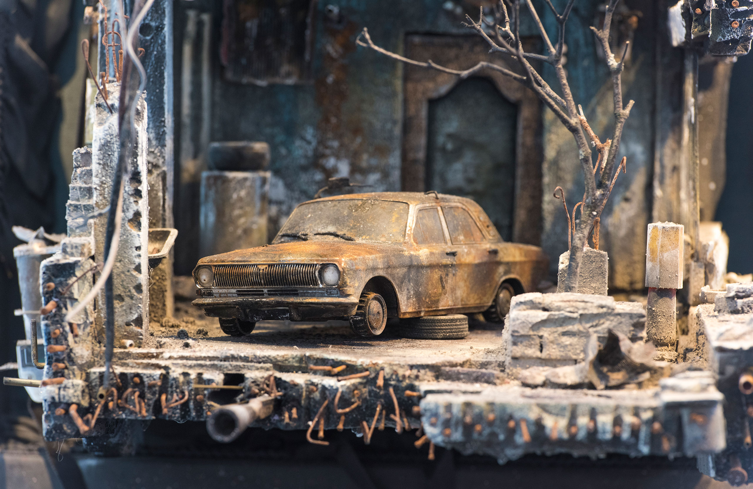 UM SHAHAM: War and a Burnt Car. Photo by Rodney Nelson.