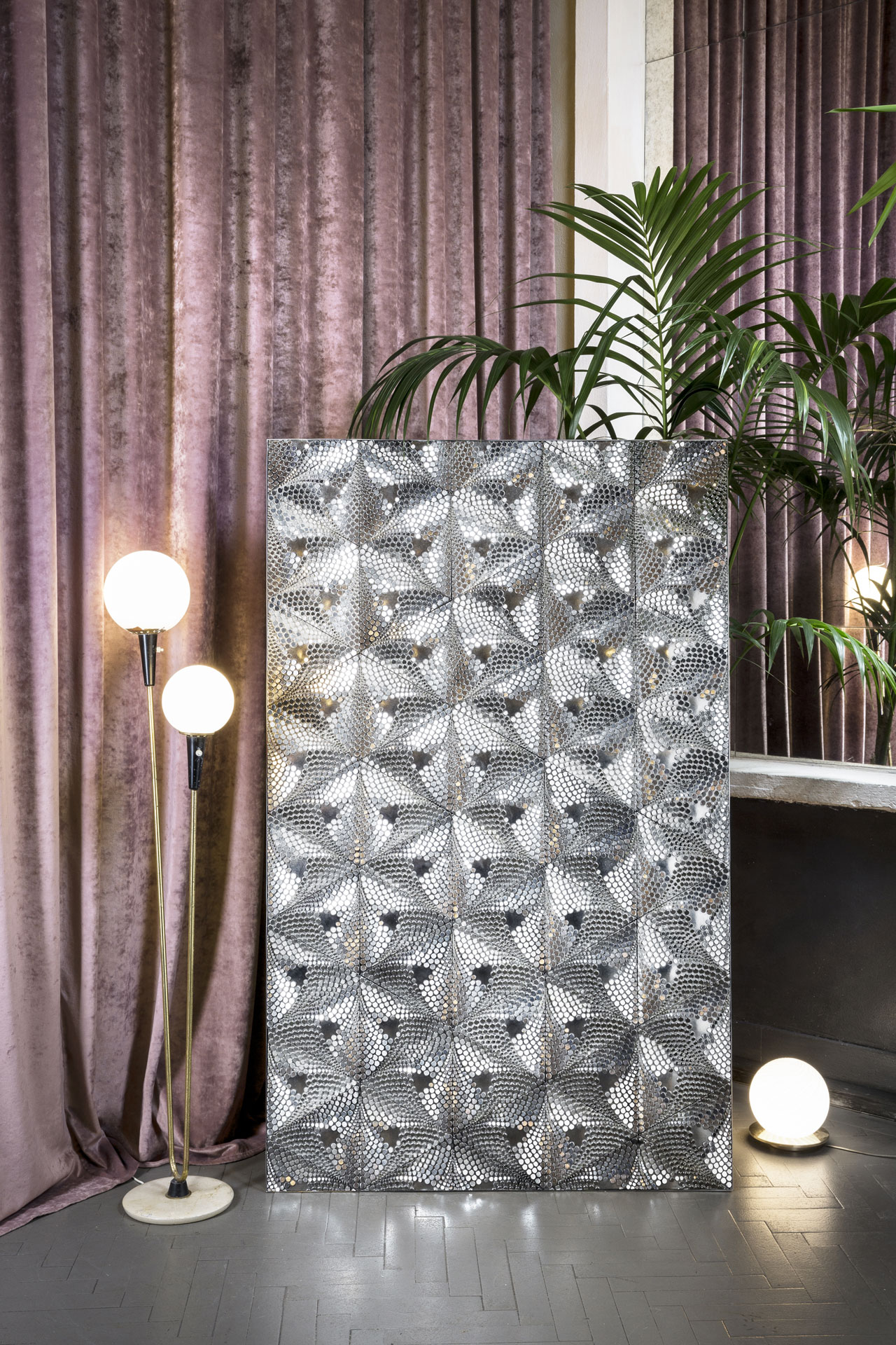 "Paillettes from the Cinetica wall covering collection by Studio Lido for Marinoni Peltro. A collection made of pewter with an exquisitely ornamental look that, as Gio Ponti used to say, ""keeps on moving with lights and shades"".  Photo © Marinoni Peltro, location Apollo Club Milano."