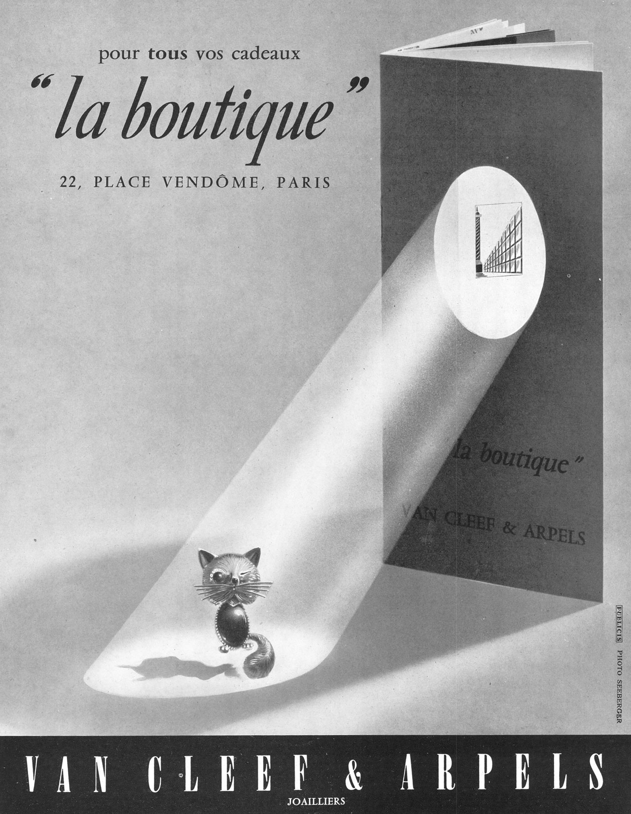 La Boutique advert, featuring the Chat Malicieux, June 1955. Photo©Seeberger.