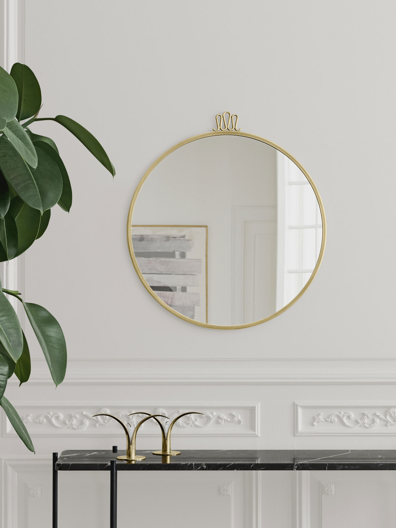 One of Gio Ponti's signature designs is the Randaccio mirror from 1925. ''Designed for his own home on Via Randaccio in Milano, his very first architectural project, the Randaccio mirror decorated the walls in his bedroom on the 3rd floor together with other furniture designed especially for the apartment.''Since 2015 the mirror is reproduced by Gubi.