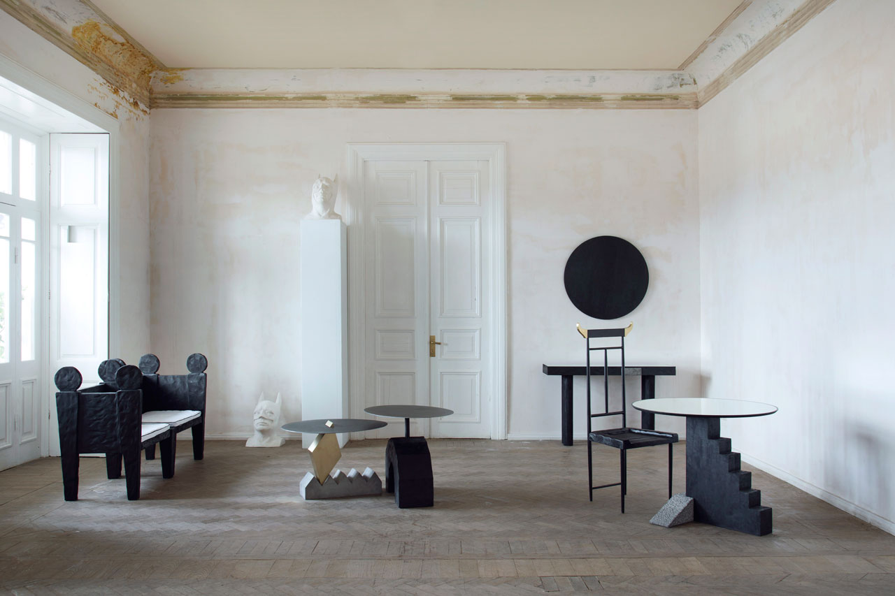 WILD MINIMALISMby Rooms. A collection of 7individual handcrafted sculpture pieces: Stone drawer console, round staircase table, 2 modular coffee tables, 2 lovers armchairs and a Taurus chair.