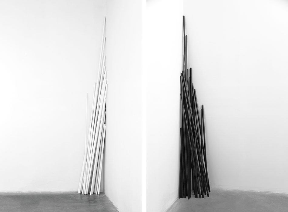 Left: Chamber Music (James Joyce). White 2014 Aluminum tubes,electrostatic painting. 36 pieces Variable heights: 80.8 – 294.7 cm x 1.50 – 2.54 cm Right: Chamber Music (James Joyce). Black  2014 Aluminum tubes,electrostatic paint. 36 pieces Variable heights: 80.8 – 294.7 cm x 1.50 – 2.54 cm Photo © Jorge Méndez Blake.