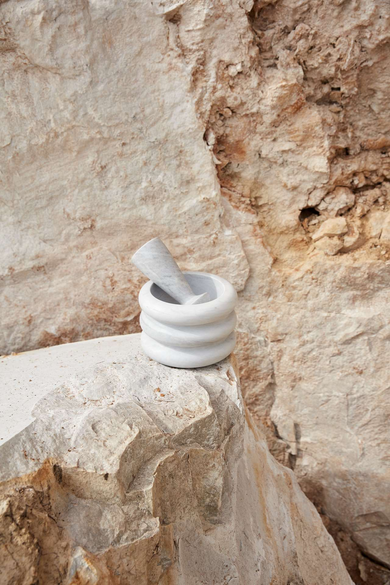 Napoleon & Josephine designed by Sarah King, Elba marble. Mortar ø175 x 110mm. Pestle ø65 x 150mm. Part of New Volumes collection by Artedomus. Photo by Sean Fennessy.