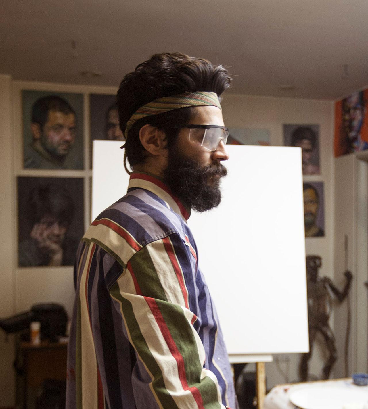 Salman Khoshroo portrait. Studio shot while working.