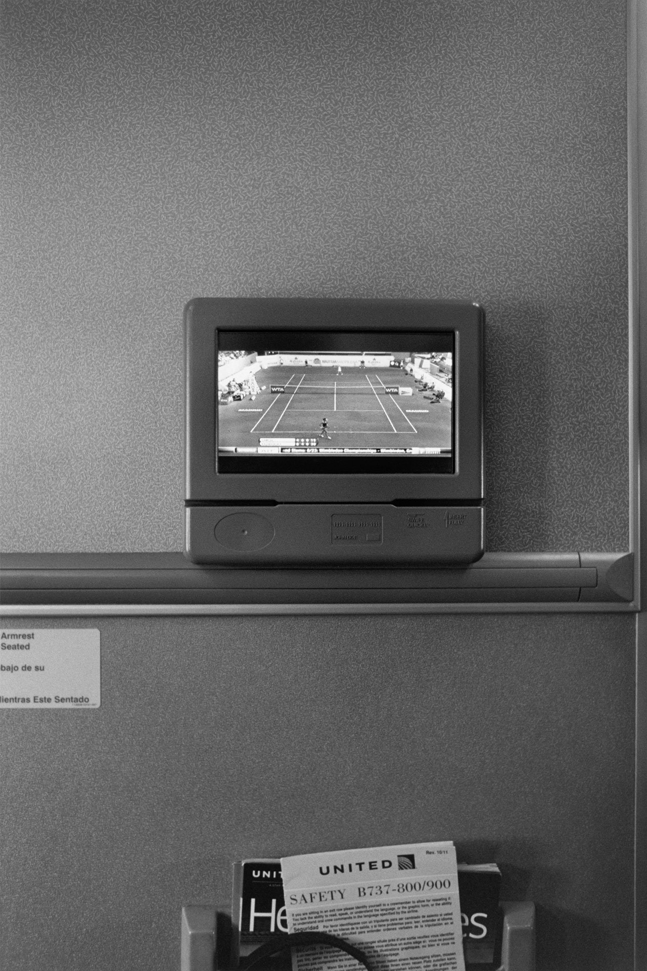 Watching tennis on United Airlines flight 2013.Photo © Stephan Würth.
