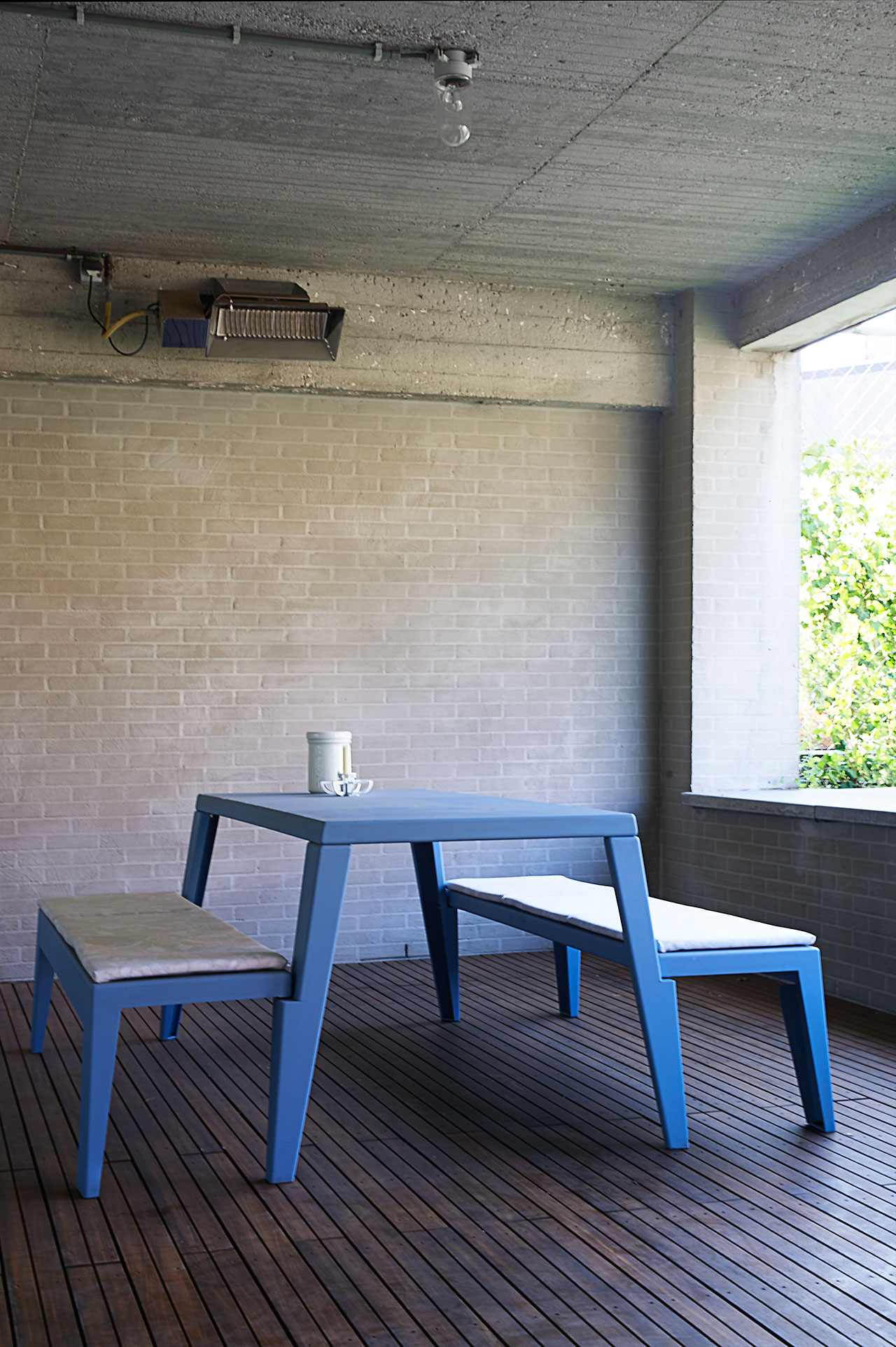 Terrace next to kitchen.Outdoor table Etcetera, Bram Boo for FELD, upholstered with Firmship Fabric by Studio Job.Silhouette Sconce, Studio Job, 2005.Pot, Royal Tichelaar Makkum, Studio Job, 2009.Photo by Dennis Brandsma.
