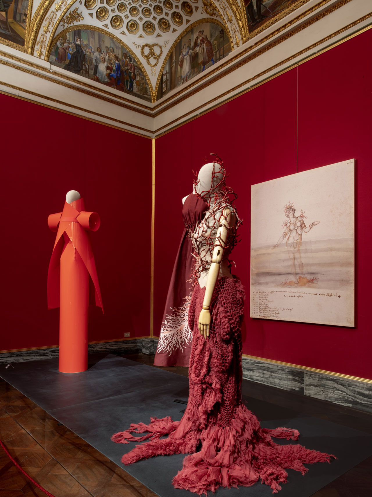 "Exhibition view (from left to right): Gareth Pugh, Dress, Spring/Summer 2018. Valentino, Dress, Spring/Summer 2018. Yiqin Yin, Dress ""Calypso"", Les rives de Lunacy Collection. Fall/Winter 2013-14 Haute Couture. Photo © Antonio Quattrone."