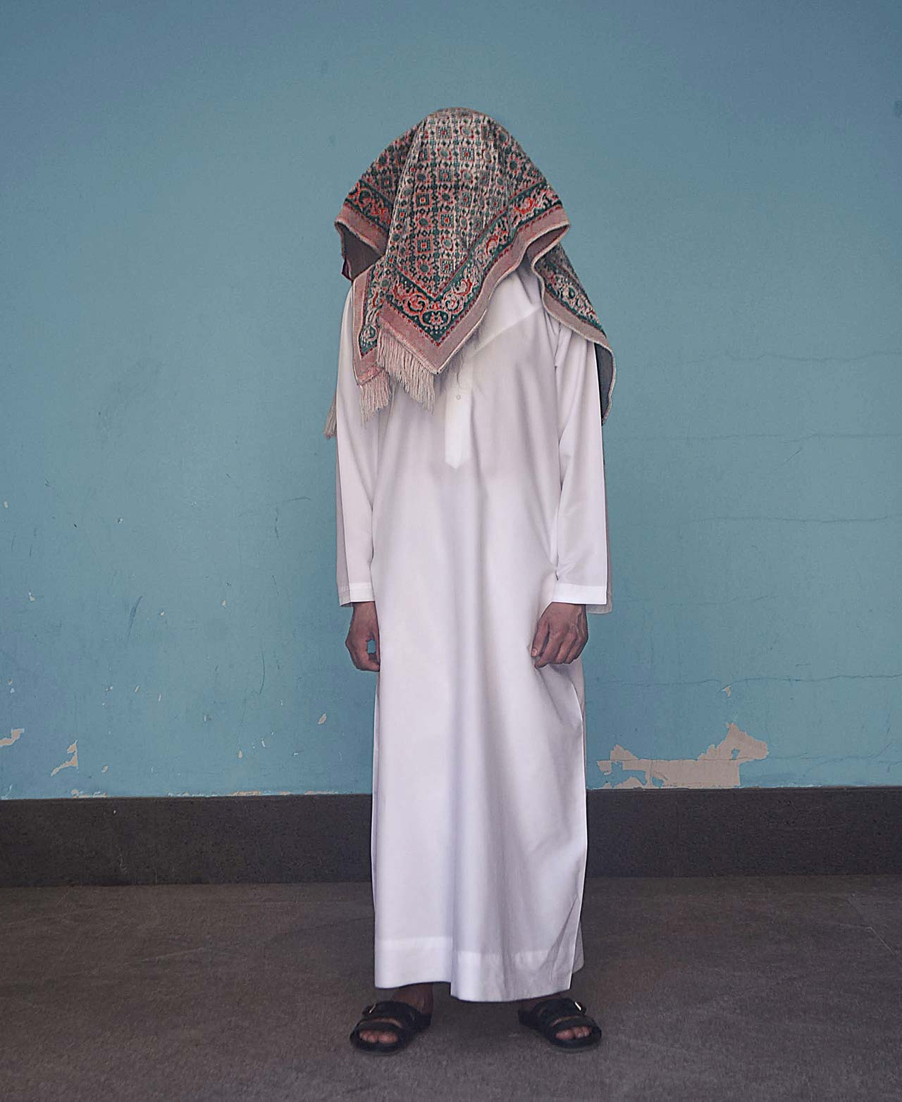 "Ali Cha'aban, The Confused Arab II from ""RUGLIFE"" series, 2016. Photo paper encased in plexiglass, 160cm x 130cm, Edition 1/5. Courtesy of Ali Cha'aban."