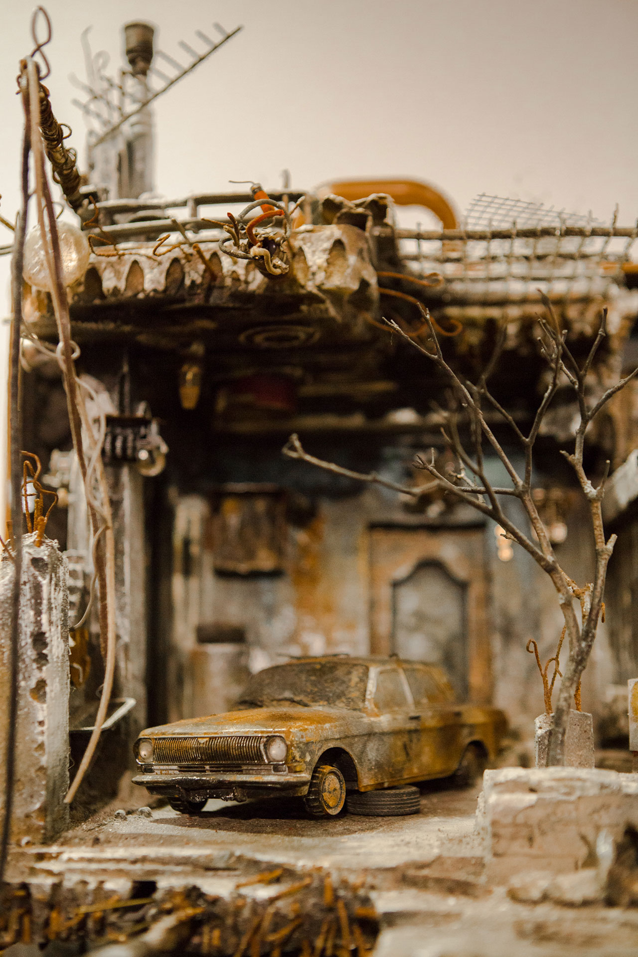UM SHAHAM: War and a Burnt Car. Photo by Anisha Sisodia.