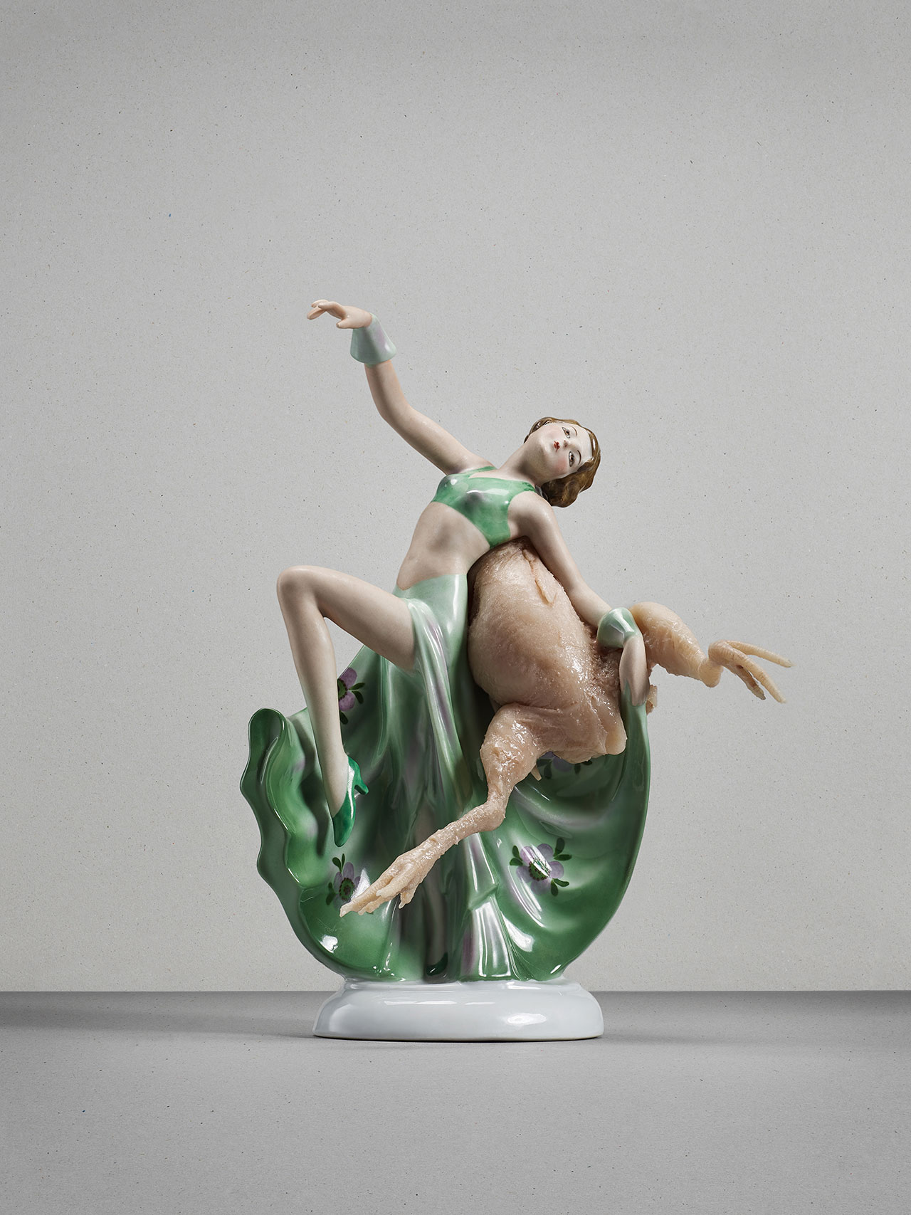 Artist Catharina Bond combines homemade silicon meat and skin with kitschy porcelain statuettes. Catharina Bond, Untitled (Dancer), 2015, porcelaine, silicone, hair. Galerie Reinthaler. Photo by Julia Gaisbacher.