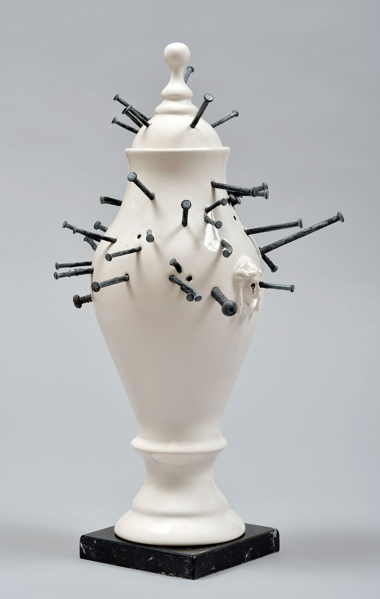 Craste Laurent, Vase Vaudou, 2014. Porcelain, glaze, nails, marble. 41.8 x 21.4 x 22.8 cm.