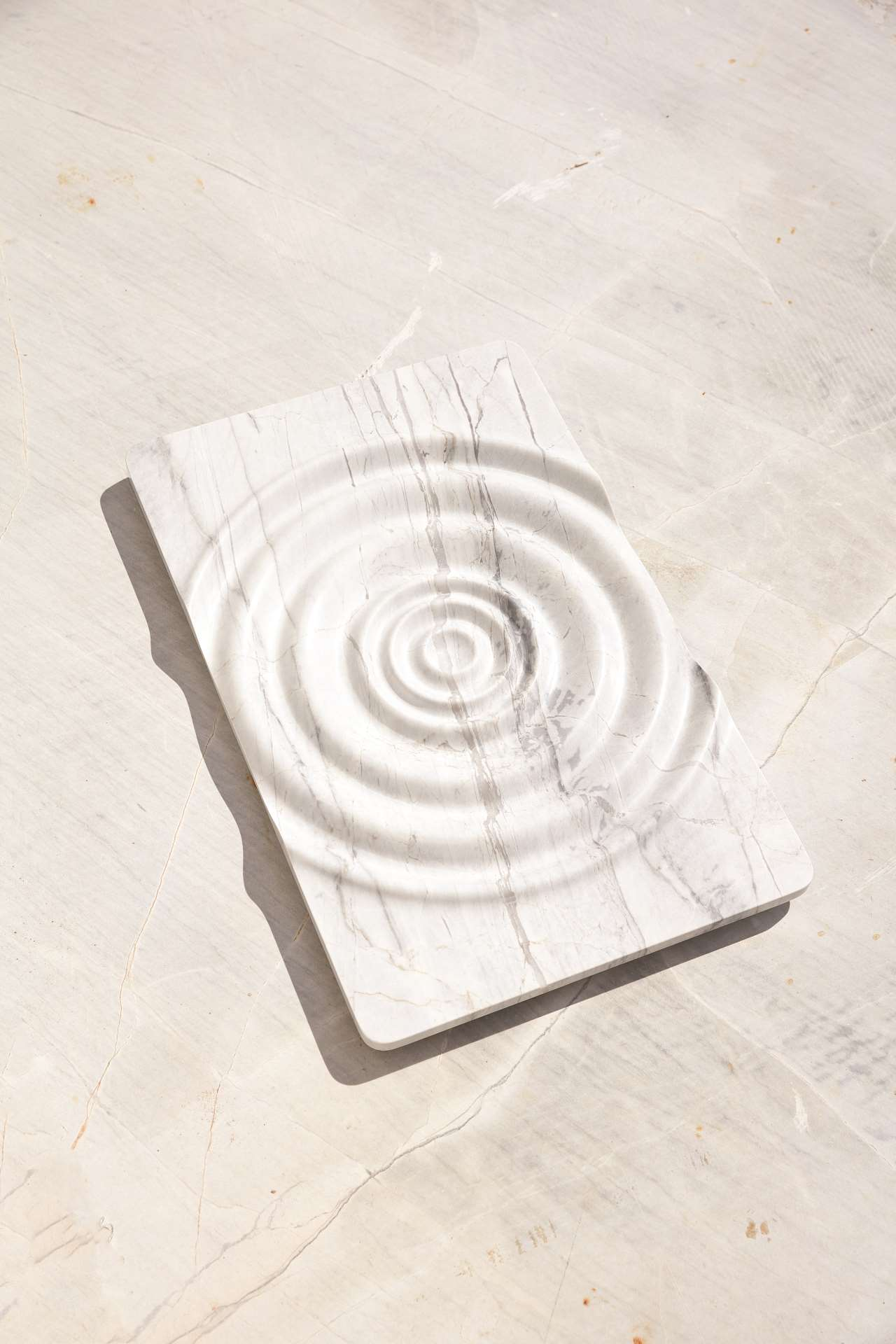 Lydn designed by Thomas Coward, Elba marble, 600 x 380 x 45mm. Part of New Volumes collection by Artedomus. Photo by Sean Fennessy.