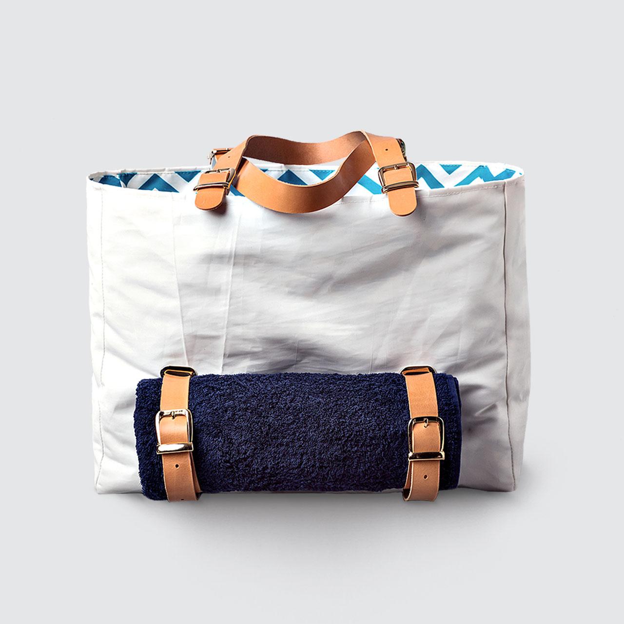 Armathea Beach bag by SALTY BAG.Photo by Nikolas TsakrisModel: Michelle Schermer, Ace Models Styling: Nikos ZanasMake Up: Gianna GiohalaHair: Agatha Chrysikopoulou