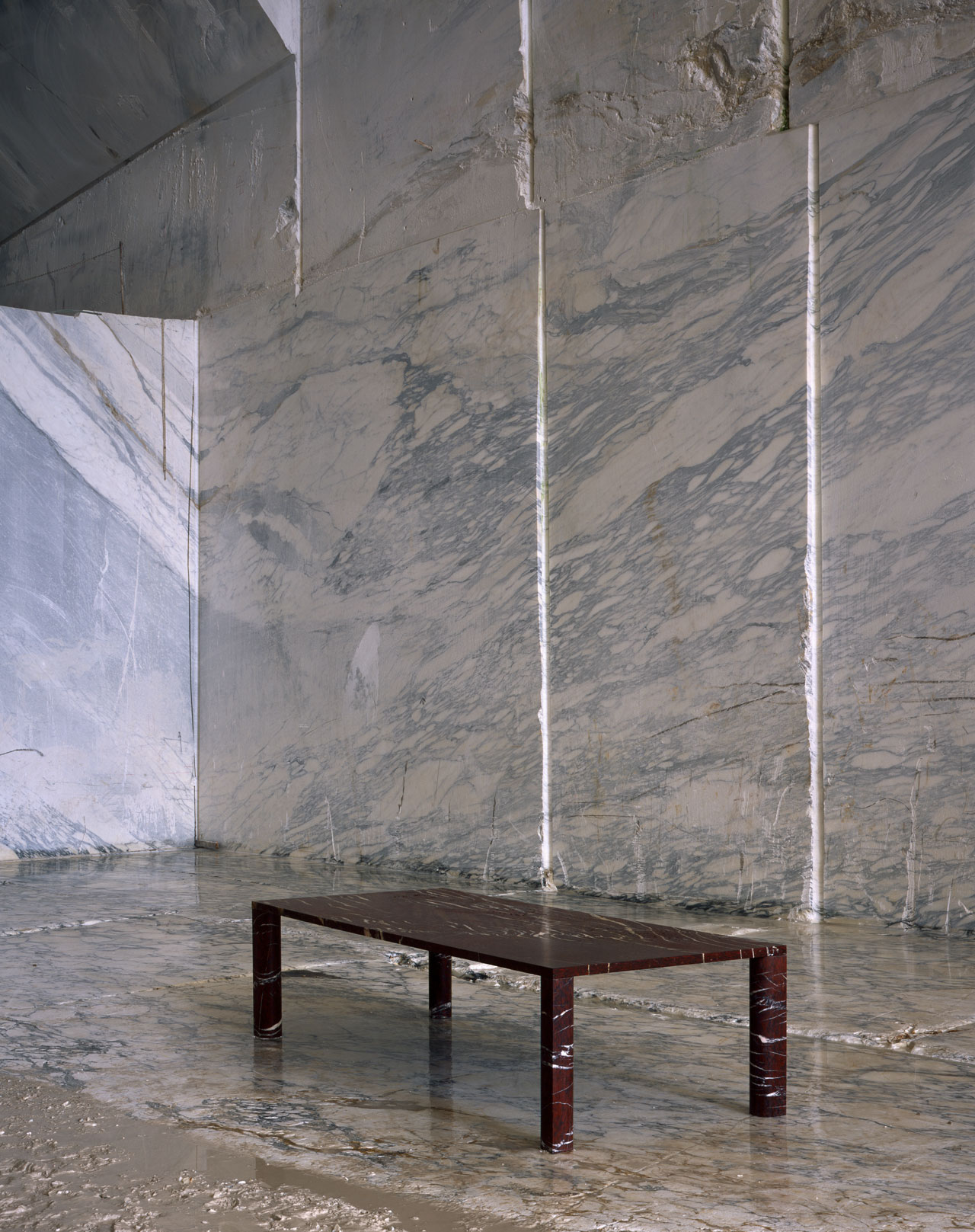Dining table in Rouge du Roi marble from the table series'LOVE ME, LOVE ME NOT' byMichael Anastassiades for SALVATORI.Photo©Hélène Binet.