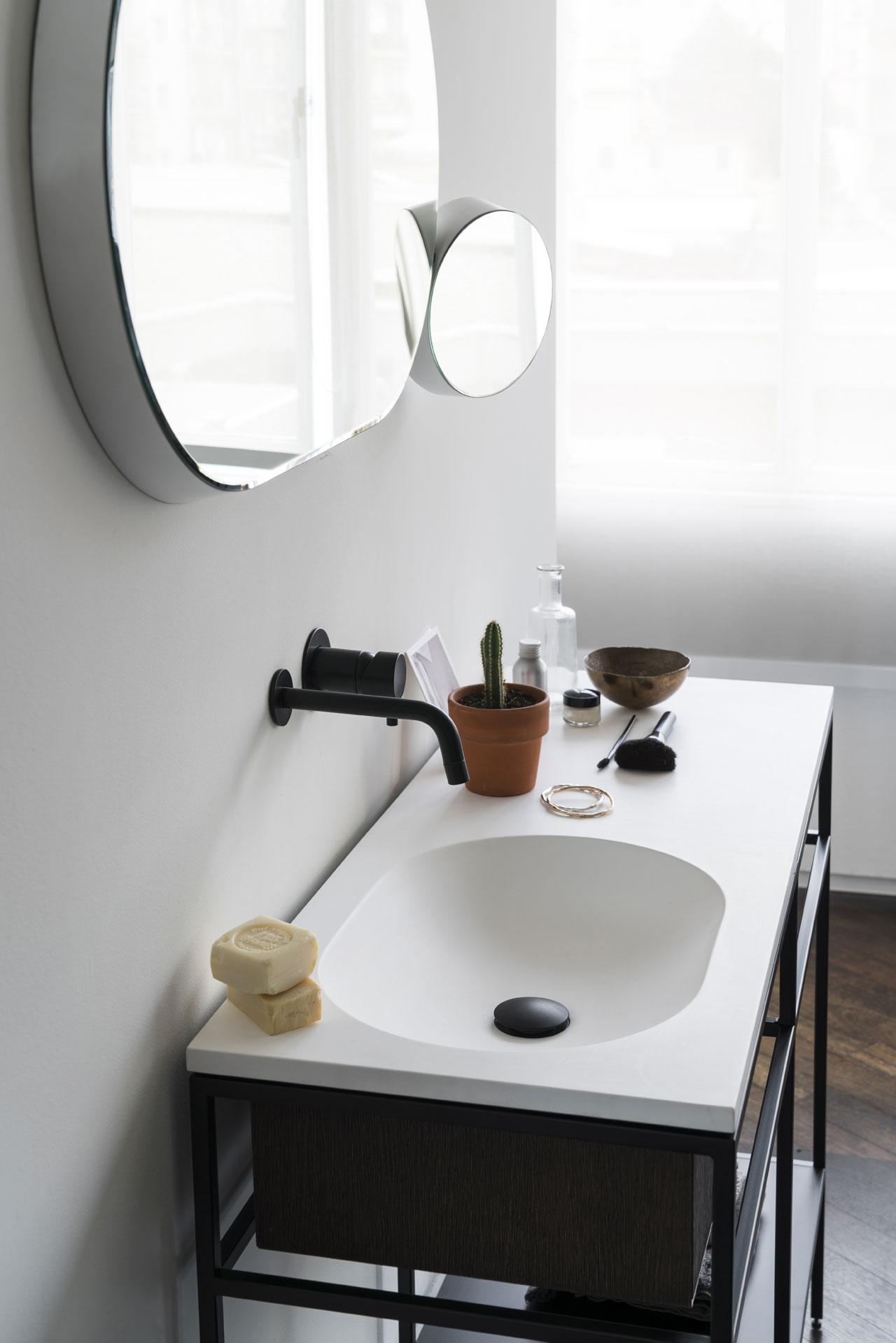 Limited edition Frame System made of Smoked oak and Navona travertine by Norm.Architects and Float & Gravity  bathroom mirrors by Samuel Wilkinson, both designed for Ex.t.