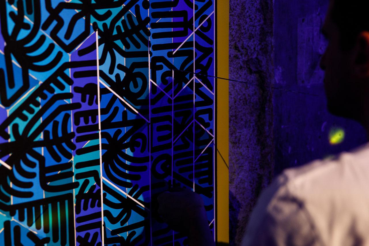 ArtistDimitris Dokos putting the finishing touches on an artworkinspired byBombay Sapphire's CANVAS brand hexagonal pattern. Photo by Spyros Chamalis © Yatzer 2019.