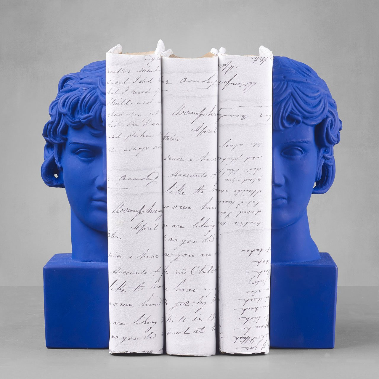 Antinoos Set of 2 Bookends.  Weight: 4500 grDimension: 29.5x6.5x16.5 cmMaterial: ceramineColor: yves klein blue