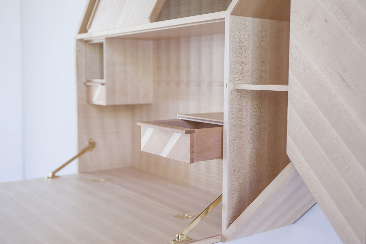 Facet by Kunsik,a wall mounted cabinet which can be used both as a storage and a writing desk.