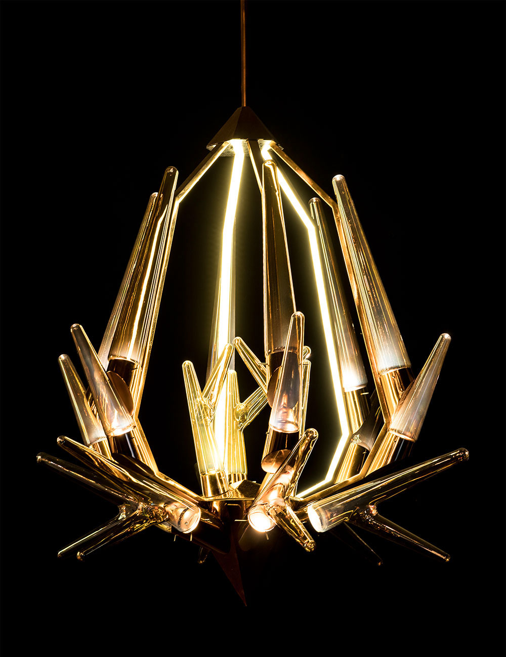 The Stag chandelier by New Delhi-based Klove Studio, inspired by the Nordic Antelope - hand crafted in glass.