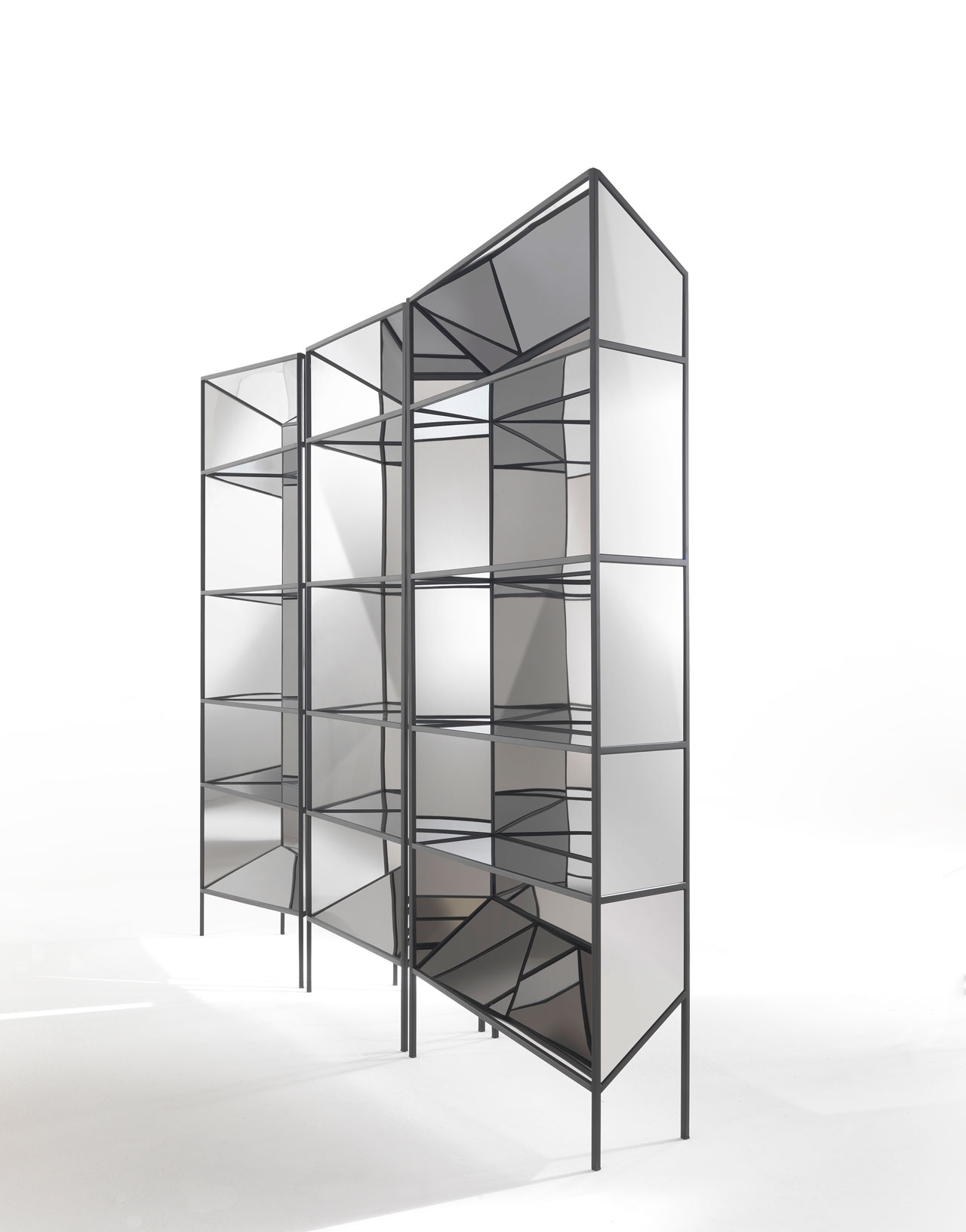 PERFLECT display cabinet by Sam Baron for JCP Universe.Materials: metal structure in grained black finish with super mirror steel panels.Dimensions (H x W x D): 200cm x 78cm x 30cm – central unit & 210cm x 110cm x 30cm – side units.Photo by Silvio Macchi © JCP Universe.