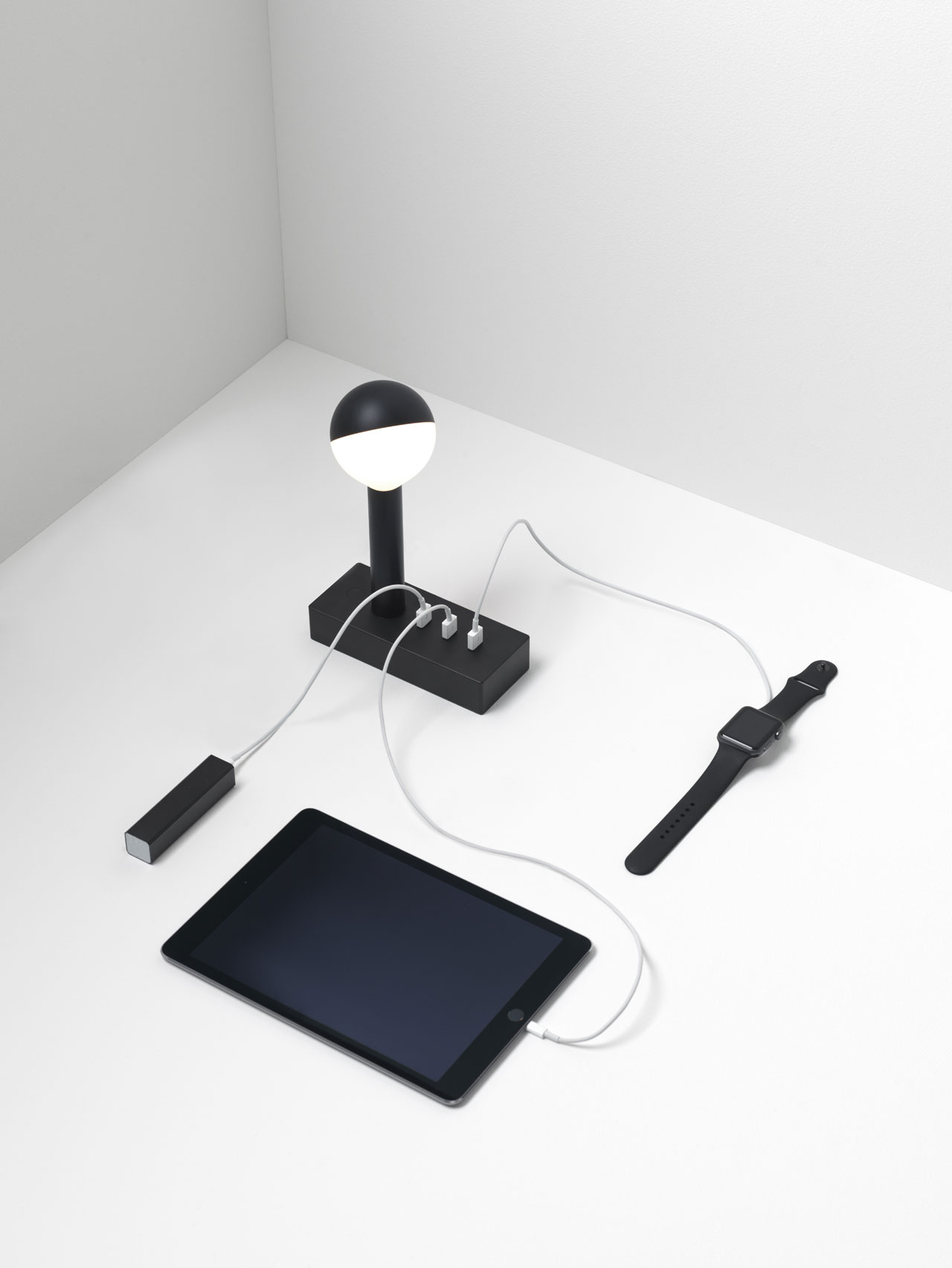 """""""The w152 Busby lamp is an electronic lamp that provides intelligent, universal power from three USB outlets, detecting charging requirements and managing them at their fastest rate.""""Wästberg in collabopration with Industrial Facility."""