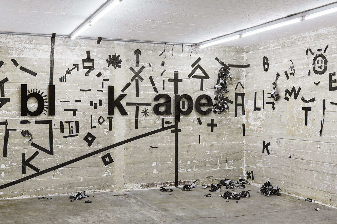 Johannes Wohnseifer, black tape (2017) | Acrylic letters, black tape /Intervention from exhibition visitors /  Dimensions variable /  Boros Collection, Berlin. Photo by NOSHE.