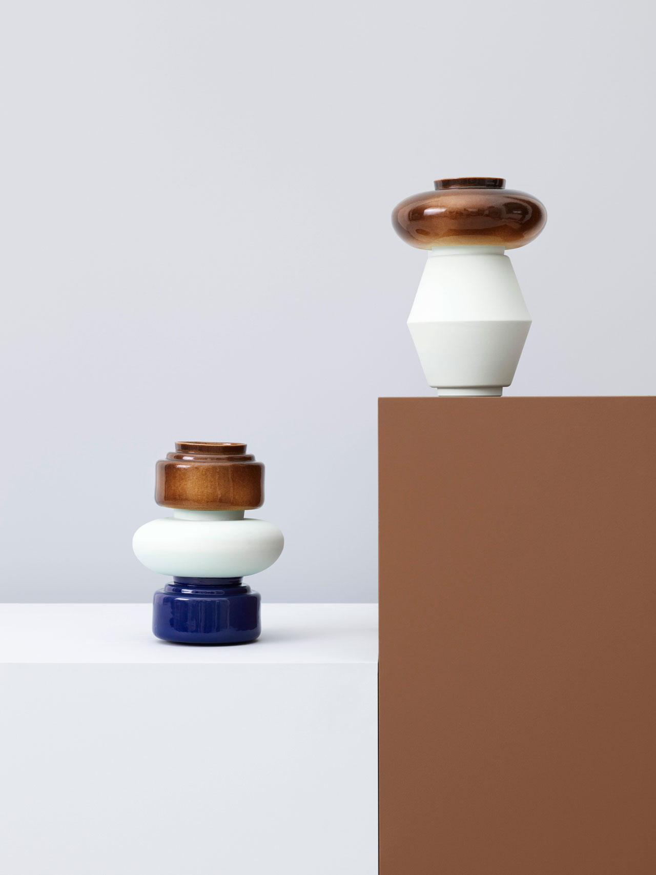 FAM, a series of five handmade slip cast porcelain vases in different shapes and colours byAnn Kristin Einarsen, part of theEverything Is Connected {Norwegian contemporary crafts and design} at Ventura Lambrate. Photo by Lasse Fløde, set-design by Kråkvik&D'Orazio.