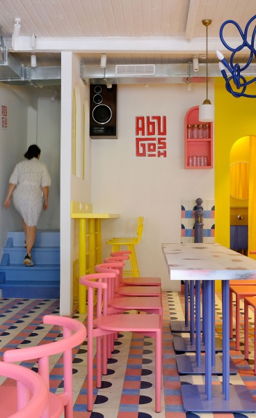 Colourful Geometric Patterns Imbue a Middle Eastern Café in Moscow with Playful Exuberance