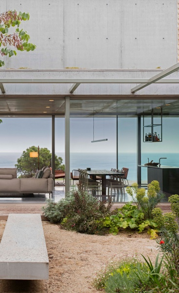 A Brutalist House in Costa Brava is Discretely Embedded into the Natural Landscape