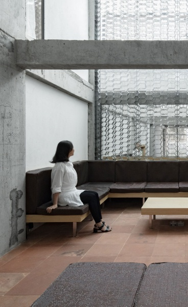 Kooo Architects Transform a Building in Guangzhou into a Minimalist Hotel of Industrial Luster